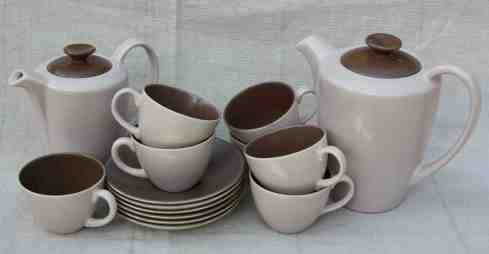 Poole Pottery coffee set including six teacups and saucers; sugar bowl; coffee pot & hot water pot. Other pieces also available.