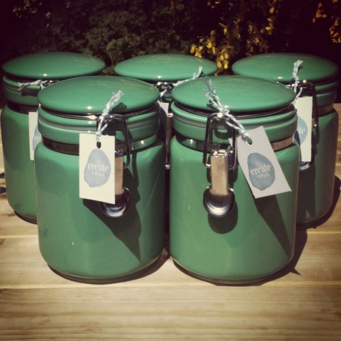 Five green vintage storage clip top canisters
