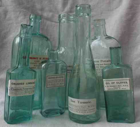 An assortment of vintage apothecary bottles