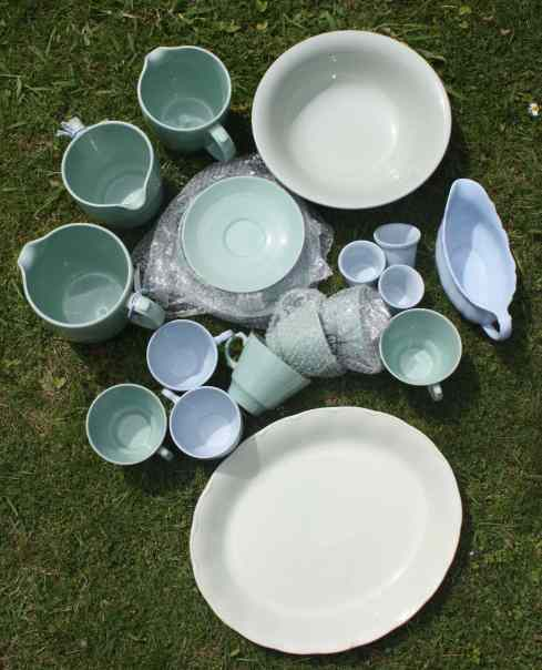 An assortment of vintage blue and green ironstone crockery
