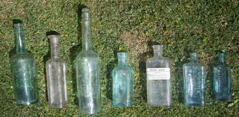 Vintage glass apothecary and condiment bottles